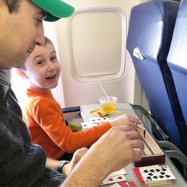 Eric taught Ethan how to play Cribbage on our flighthellip